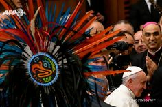 Pope Francis greets a group of people from Mexico during his weekly general audience at the Paul VI audience Hall on December 7, 2016 in Vatican. VINCENZO PINTO / AFP