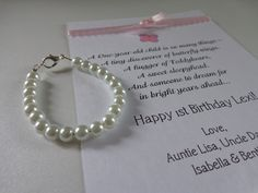 BABY GIRL 1st Birthday Gift Pearl Bracelet with Birthday Card, First Birthday Keepsake, 1st Pearls, Birthday -- FREE Gift Packaging. $12.99, via Etsy.