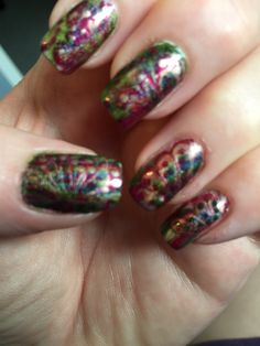 Water marble over white base of China Glaze Passion and Seduce Me, and Zoya Envy. KB Shimmer a Prism Break over all, with dots from CG Passion.