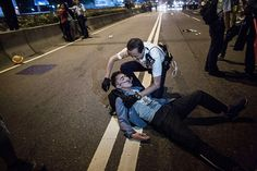Umbrella Revolution Hong Kong, Riot police arrest a pro-democracy protester during clash outside Central Government Complex on November 30, 2014 in Hong Kong. According to reports, hundreds of pro-democracy protestors and police faced-off with at least fice potestors arested. (Photo by Lam Yik Fei/Getty Images)