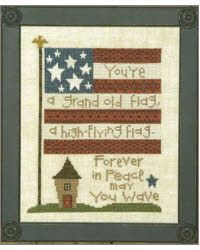 """""""You're a grand old flag, a high flying flag"""", """"Forever in peace may you wave"""". Model stitched on 18 count Linen with DMC floss and Weeks Dye Works. The stitch count is 98W x 121H."""