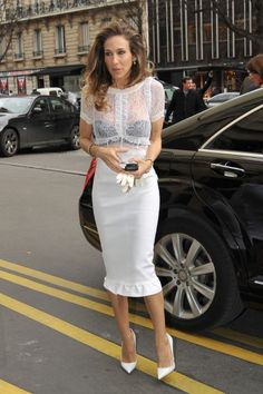SJP at the Paris Louis Vuitton show, channeling her inner Carrie Bradshaw with the peek-a-boo black bra under white lace and voluminous hair