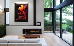 Mid-century #modern #home with a live edge coffee table, Peter Lik photography, and beautiful #fireplace #design