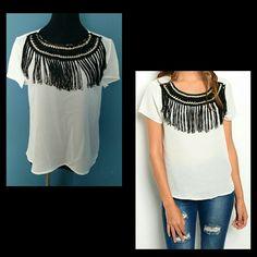 "Cream Blouse. Black Fringe Neckline. Fabulous cream blouse. Knit print neckline with chain links and fringe. Solid cream back. NWOT.  Length: (S): 20.25"" (M): 20.75"" (L): 21.25"" Armpit to armpit: (S): 18"" (M): 19"" (L): 20"" Xtaren Tops"
