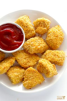 Parmesan Baked Chicken Nuggets -- easy to make, and much tastier and healthier than the fried version! | gimmesomeoven.com