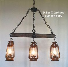 Rustic Chandelier Light Fixture With Single Tree and Three Hanging Lanterns