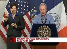 Lydia Calas, Mayor Michael Bloomberg's ASL interpreter, struggles to capture his animated delivery.