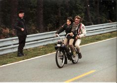 Steve McQueen on a Velosolex with his son Chad in Le Mans 1970