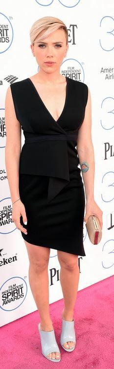 Scarlett Johansson's black peplum dress, gray shoes, and clutch handbag red carpet fashion id