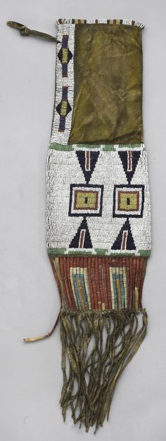 A Sioux beaded pipe bag  With distinct geometric patterns on each side, a band down the yellow-dyed neck, quill-wrapped slats and fringe suspensions.  length 28in