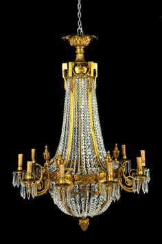 Neoclassical style gilt bronze and crystal eight-light basket shaped chandelier