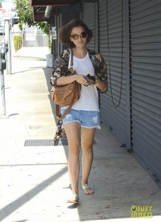 Lily Collins wearing STROM Brand Kort Star Shorts, Topshop Feather Duster Kimono, Givenchy Pandora Bag in Cigare.