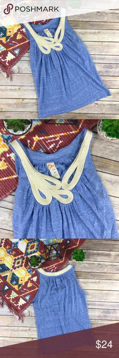 Anthropologie C. Keer Paisley Swoop Rope Tank Top Anthropologie C. Keer Paisley Swoop Rope Tank Top in Blue and Cream. Swirled rope appliqué around neckline. Blue heather burnout jersey knit fabric body. Super soft.   Size: Medium  Fabric: 45% Cotton 45% Poly 10% Rayon  Condition: Pre-loved.  Minimal signs of wear.    Notes: *All measurements are taken flat *Additional measurements upon request  *Pre-owned items may have been laundered Anthropologie Tops Tank Tops