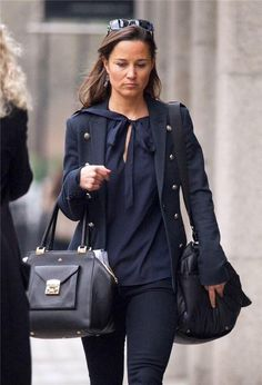 The Muse Jacket from Superdry in navy,  Milli Millu Luxembourg bag, and her Sweaty Betty 'On the Go Luxe Gym' bag