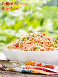 Grilled Salmon Rice Salad with carrots, green onions, peas, bell pepper, and a lemony white wine dressing. It's a wonderful make-ahead salad for a party or potluck.