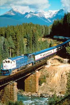 Mountains, train, bridge, and water