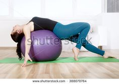 Girl doing stretching her body while lying on gym ball. Concept: lifestyle, fitness, aerobics and health. Aerobics, Stretching, Bean Bag Chair, Concept, Exercise, Gym, Stock Photos, Lifestyle, Health