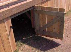 An open gate in a deck skirt showing gate construction detail. - An open gate in a deck skirt showing gate construction detail. House Skirting, Deck Skirting, Under Deck Storage, Lattice Deck, Laying Decking, Under Decks, Deck Construction, Front Deck, Front Stoop