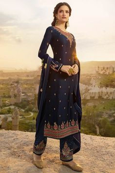 This Navy Blue Satin Georgette Trouser Suit which will surely grabs everyone attention. Teamed up with Satin Georgette Trouser in Navy Blue Color with matching Georgette Dupatta. Trouser has Resham, Zari and Stone work. Dupatta perfectly formed using Resham, Zari and Stone Work.