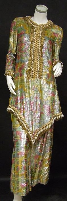 """Oscar de la Renta Siamese Queen Pantsuit - Gifted by the aluminum company Alcoa to Clare Ritter in 1978... a yellow, pink, green and blue aluminum cloth pantsuit trimmed with aluminum coins and teardrop pearls... dubbed the Siamese Queen. Long tunic and matching pants. Fully lined in ivory silk. Tunic zips up the front with a nylon zipper. Pants have a side nylon zipper. """"Oscar de La Renta,"""" label. , Vintageous"""