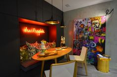 'Hard to explain' Neon as artwork in a kitchen by designers Lisiane Scardoelli and João Pedro