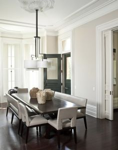 Dining room with an asymmetrical five-arm chandelier
