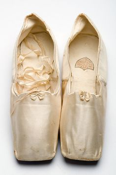 Satin slippers, 1833, bear a label from the Parisian shoe maker ESTÉ. Charleston Museum