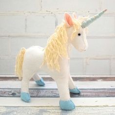Enhance Child Development With Toys. Parents who are trying to find toys that will improve children advancement need look no more. You have numerous options for toys, they have flooded the mar Diy Unicorn Doll, Unicorn Gifts, Stuffed Animal Patterns, Stuffed Animals, My Little Unicorn, Pouch Pattern, Unicorn Pattern, Felt Toys, Easy Gifts