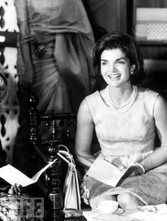 "Jackie Kennedy sits and smiles during her tour of India. ""I always wanted to be some kind of writer or newspaper reporter. But after college ... I did other things,"" she said."