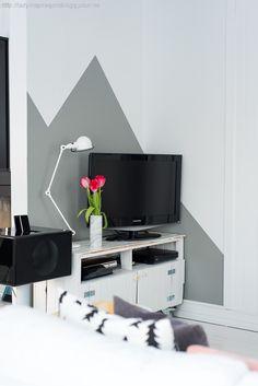 geometric wall behind tv