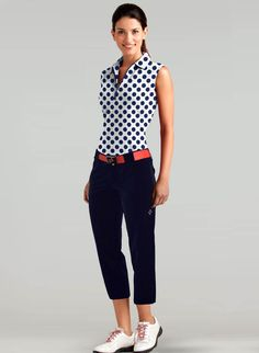 Pair navy polka dots with coral for a fun and energetic look on the golf course! | #golf4her #jofit #golf