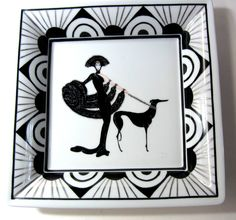 Large tray painted with an Erte figure in black and white and platinum