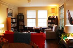 Ben's Warm & Cozy Austin Apartment - Yellow walls and red sofa