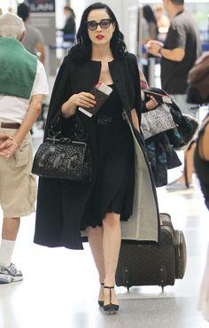 Dita Von Teese--dressed up even to travel!