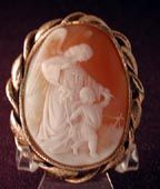 This is a FINE AND RARE CAMEO OF THE GUARDIAN ANGEL.She is walking with a lovely Victorian child.The setting is heavy 15 ct gold not marked but tested.Has the c and t pin.From around 1860.The size is 2 by 2 1/4. Has a tiny loop on the bottom for a safety chain.Much nicer in person.The setting is engraved..It weighs 24.1 grams