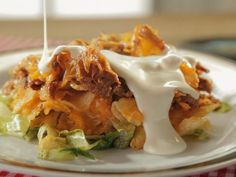 Get Memphis-Style Pulled Pork Nachos Recipe from Food Network