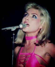 blondie plastic letters for the cover of the second blondie album plastic letters chrysalis deborah harry wore a hot pink dress with a pencil skirt