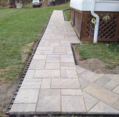 Beautiful paver sidewalk with diagonal details Wet Basement Solutions, Sump Pump Drainage, Paver Sidewalk, Fill Dirt, Landscape Drainage, Drainage Solutions, French Drain, Crushed Stone, Floor Drains