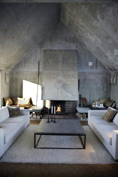 #concrete #wall #fireplace... This is actually cold - I would punch it up with color - all the brights would liven it up. But the space is wonderful and the furnishings perfect.