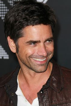 OK, Stamos is undeniably hot, but he's also smart and, like Jon Hamm, gets WAY sexier when he's making fun of his own image. . .