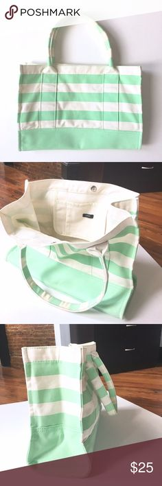 J. Crew Boardwalk Tote J. Crew Boardwalk tote, in a nautical off-white and seafoam/turquoise/teal striped pattern. The bag has a single magnetic button closure, with one interior pocket. Material: canvas. This bag is great for the beach, park, or... the boardwalk! Shows signs of very light wear, still in great condition. J. Crew Bags Totes