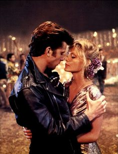Grease 2 They may not be Danny and Sandy, but Michael (Maxwell Caulfield) and Stephanie (Michelle Pfeiffer) have similar smoldering chemistry.