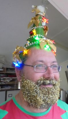 Christmas tree hairstyle. Fairy lights, green hair spray, xmas hair, crazy hair day, #glitterbeard, trend, glitter beard