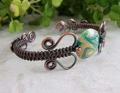 This gorgeous copper bracelet is from a free tutorial offered by Wickwire Jewelry. Thanks so much ~ I have just the focal bead for it!
