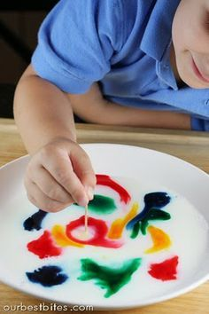 Place milk in shallow dish- add drops of food coloring. Now grab a *magic* toothpick.  What? You don't know where to buy magic toothpicks?? Just dip the end in dish soap & touch the milk with it. Colors instantly shoot out at lightning speed creating a wake of rainbows!  Try dipping the toothpick in the color first and then the milk and you'll make rings. Do not drink the milk ;)