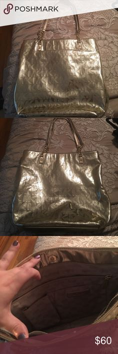 Michael Kors metallic gold tote purse. Like new Michael Kors metallic gold tote purse. Like new great Condition KORS Michael Kors Bags Totes