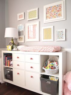grey and pink nursery.- made from Expedit bookcase from IKEA. Legs also from IKEA in kitchen area. Knobs from Anthro. Galvanized tubs/bins from Lowes.