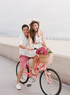Love everything bot this but the guys pink shorts! Engagement Props, Engagement Outfits, Beach Engagement, Engagement Pictures, Wedding Couple Poses Photography, Engagement Photography, Bike Couple, Bike Photoshoot, Hermosa Beach