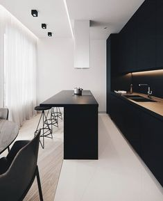 minimal and modern black and white kitchen with a bar