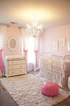 Pink Nursery; I love how they tied the curtains with the big bows